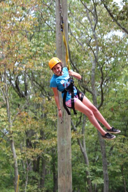 girl on zip line harness